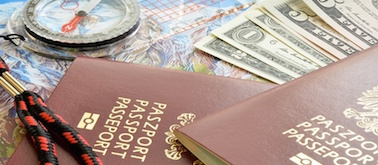 passport, US Dollars and compass